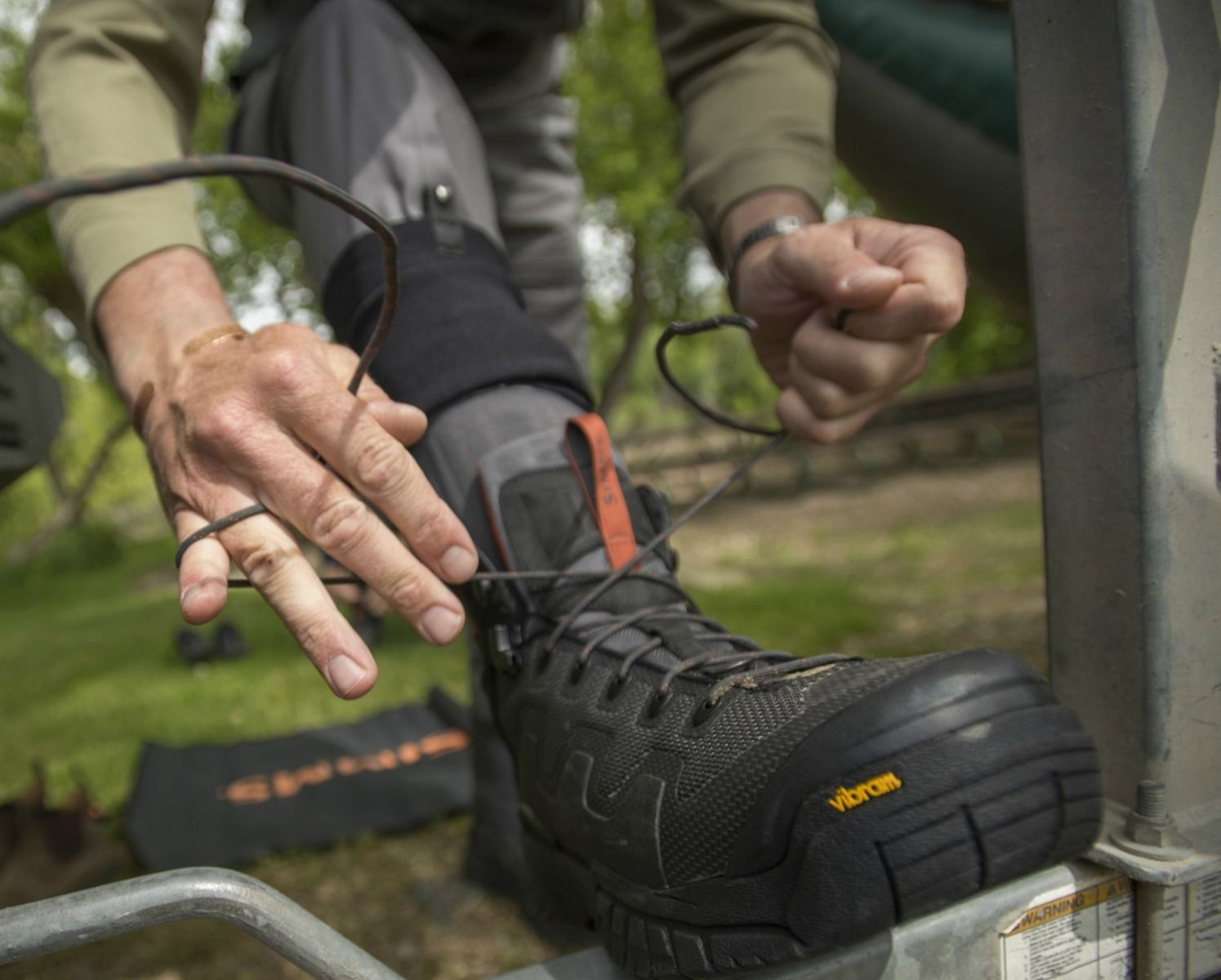 Wading Boots Simms G4 Pro Vibram Soles Carbon - In Action